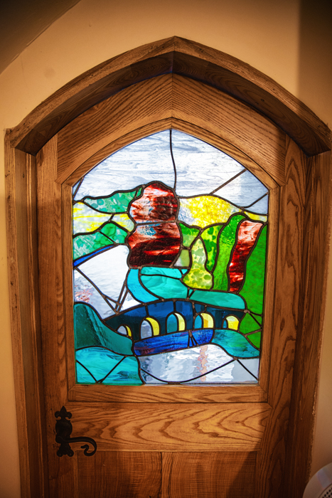 Stained glass windows are featured throughout Pod Hollow at West Stow Pods.