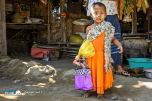 Burmese girl with her doll