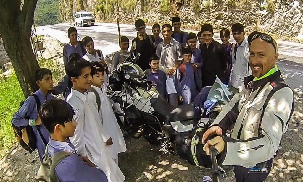 Students surround me when I stop for a sip of water in rural Pakistan