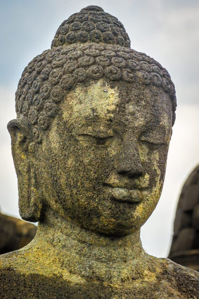 Stone bust of Buda in Indonesia