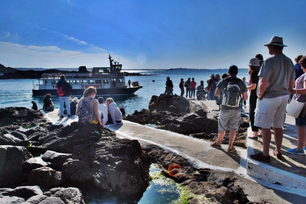 People waiting on the Rosaire Steps for the ferry back to Guernsey