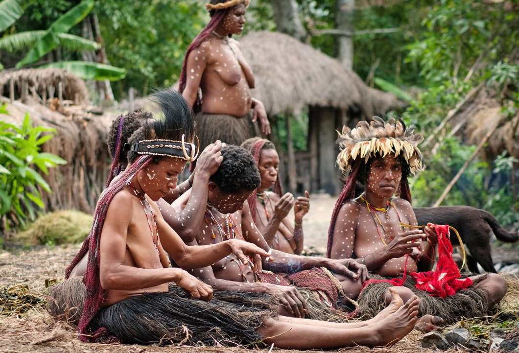 Tribal ladies doing their daily chores