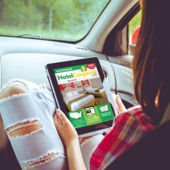 Woman Reading HotelCoupons Guide in Car on Tablet