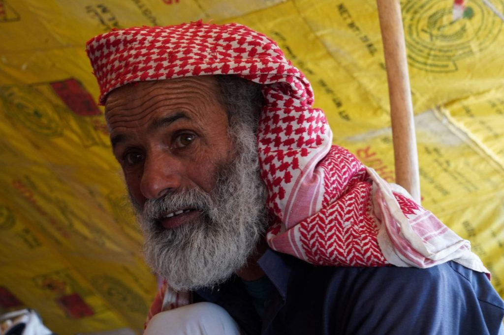 Bedouin host answers questions in his home near Dana Biosphere Reserve, Wadi Arabah, Jordan, image by Marie Goff