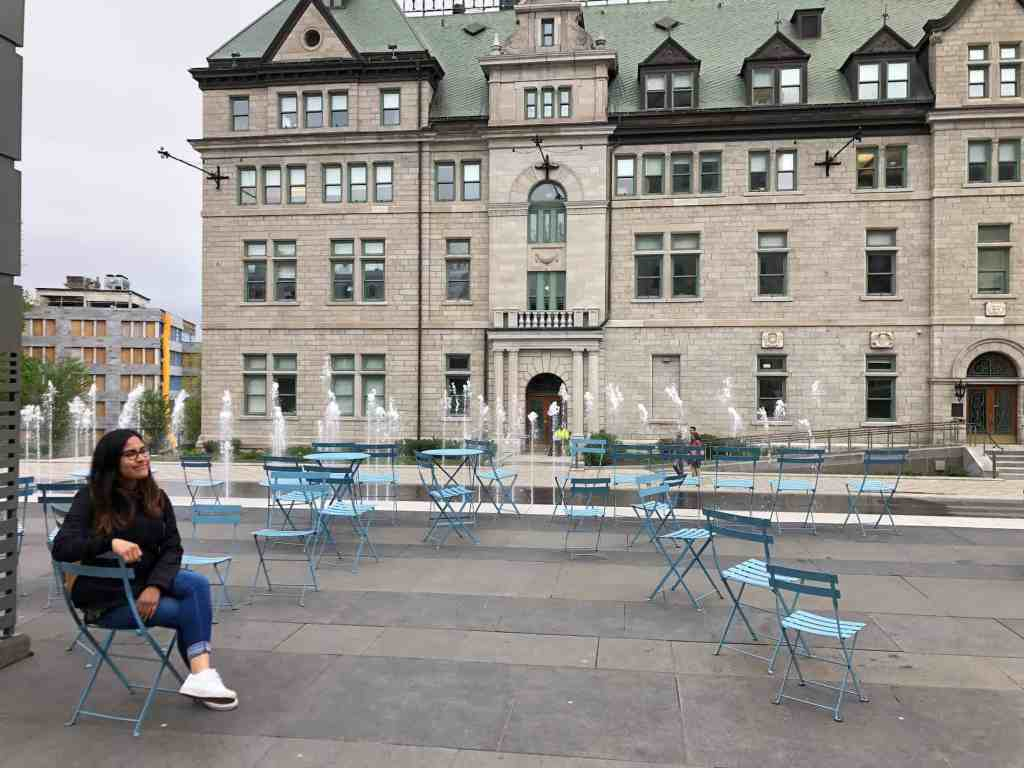 girl sitting in a blue chair in quebec city canada