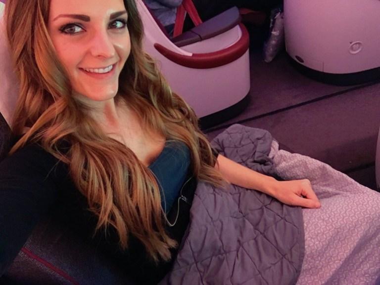 Kashlee Kucheran full time traveler on Qatar Airways flight