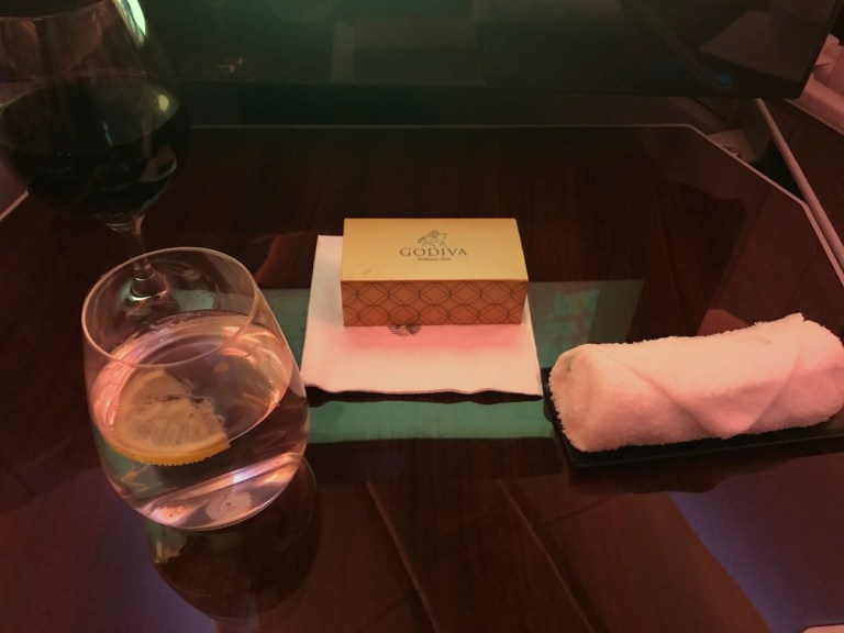 Qatar Airways with Godiva chocolates and red wine