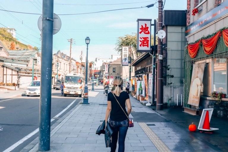 Kashlee watching through the streets of Otaru