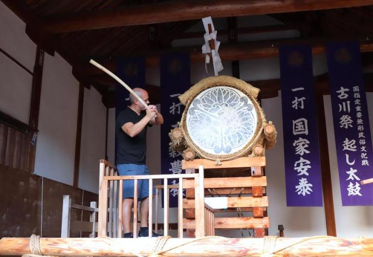 Trevor Kucheran banging the drum in Hida Japan