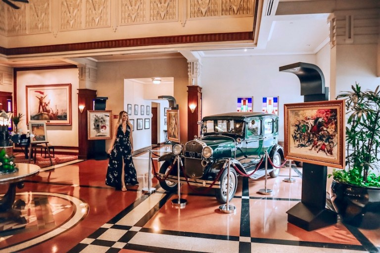 Art Deco lobby and classic car at the Majapahit Hotel