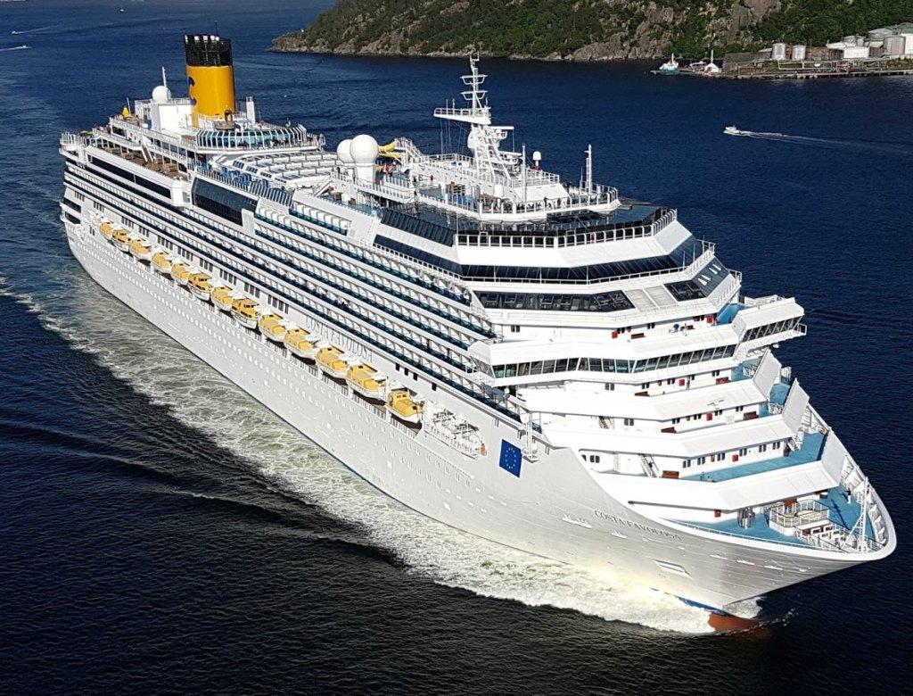 Costa Favolosa cruise ship in dark blue ocean