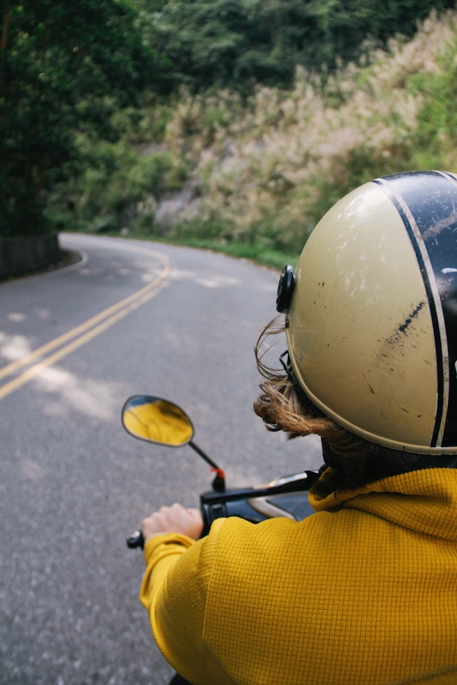 wear a helmet when traveling - travel safety tips