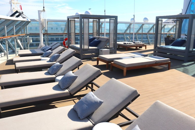 sun loungers and cabanas on rooftop retreat Millennium