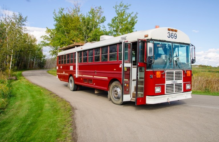 red school bus made into mobile home