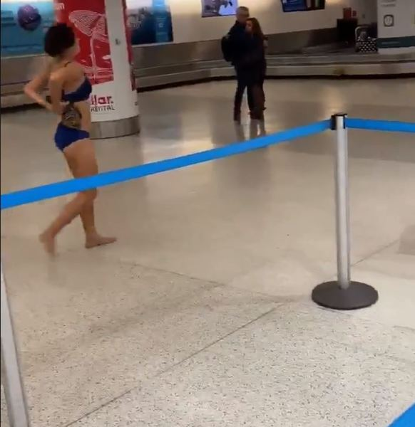 Naked Woman Wanders Miami Airport And Jumps On Police Car