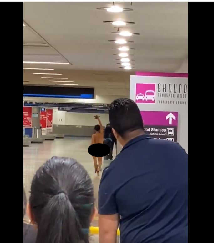 Woman strips off clothes in Miami airport then sits naked