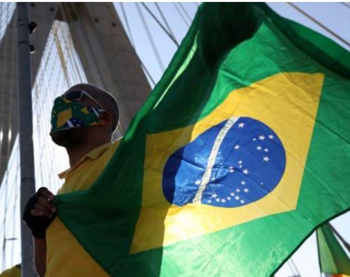 Brazilian carrying national flag