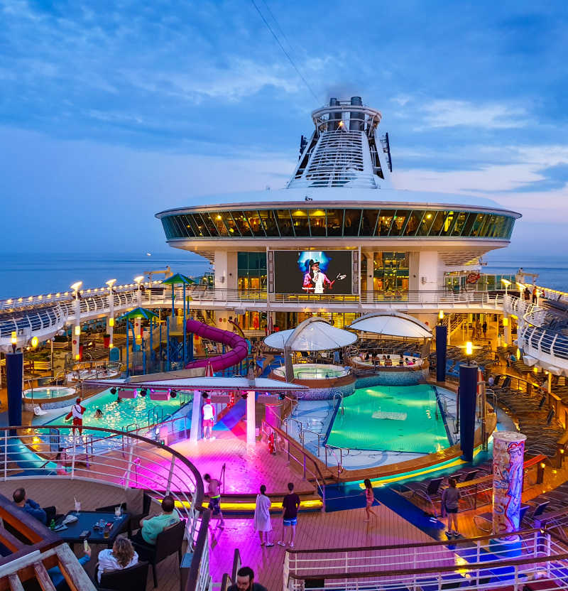 Royal Caribbean Cruise pool Deck lit up at night with lights