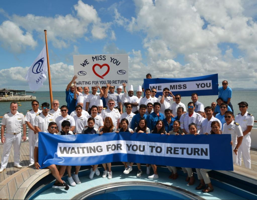 SeaDream Superyacht staff with we miss you sign