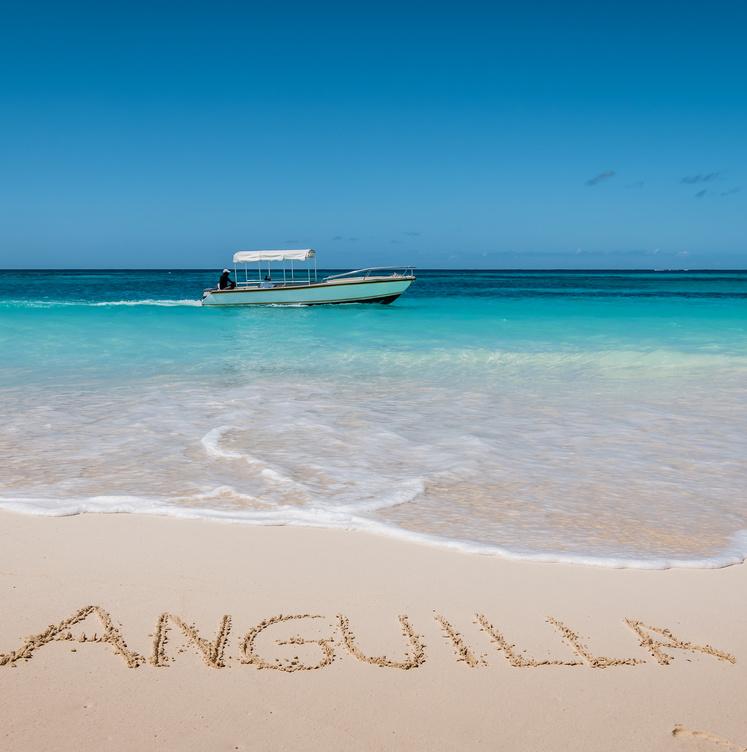 Anguilla written in sand on beach