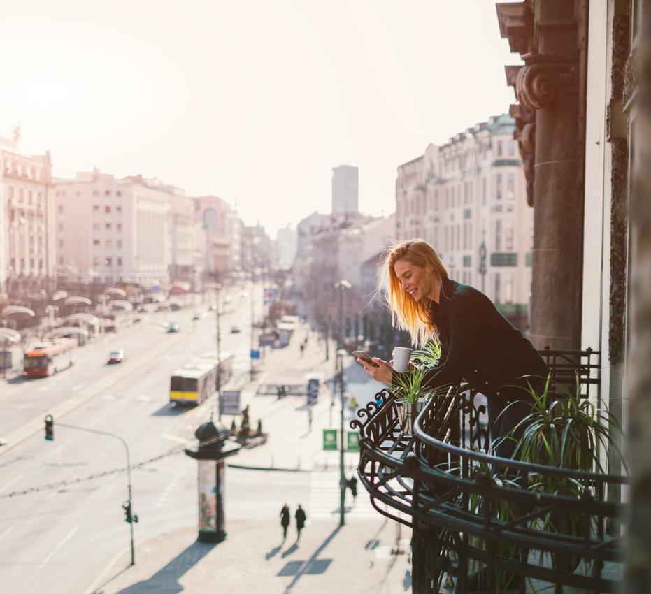Traveler having coffee on balcony in Belgrade serbia