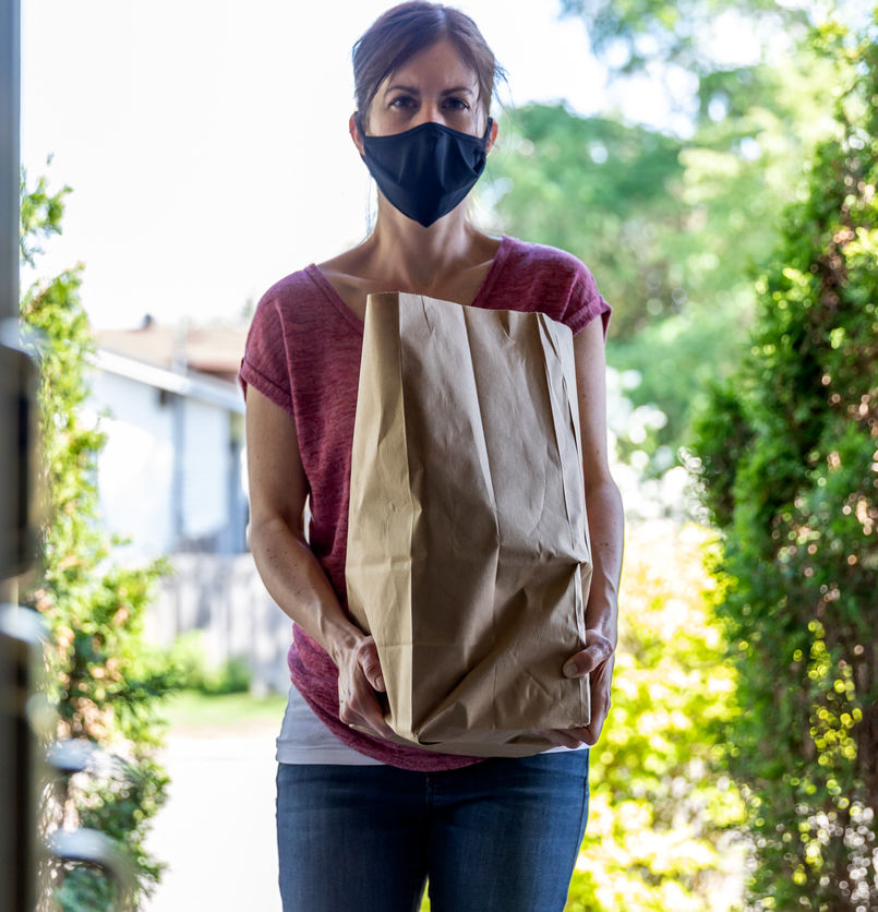 Woman delivering groceries for Canadian in quarantine
