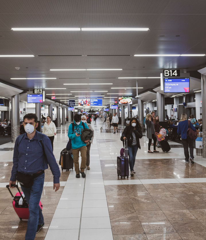 Passengers wear masks at airport