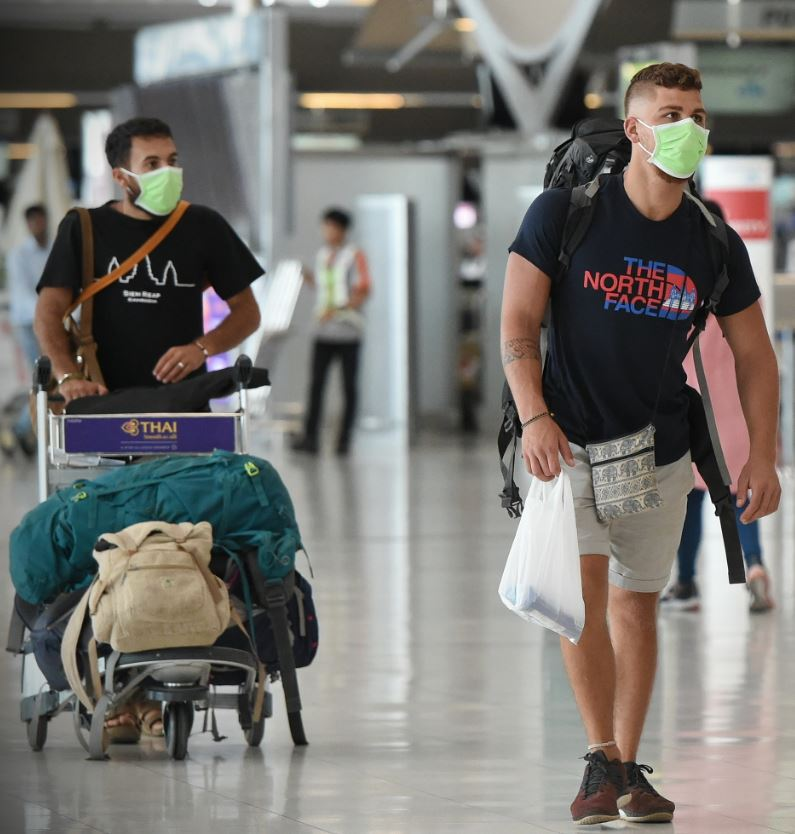 backpacker with mask airport