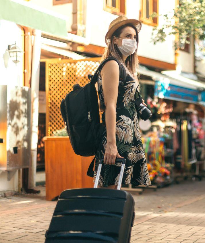 tourist woman mask luggage