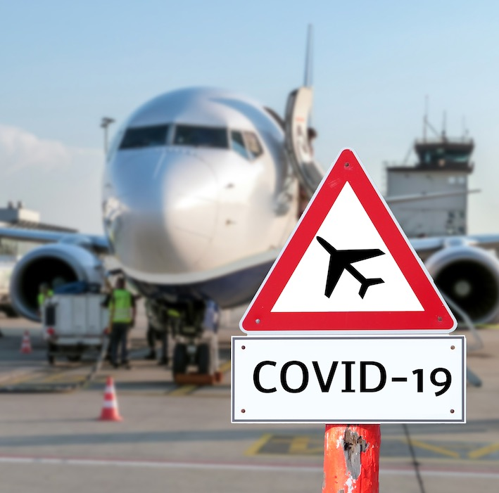 COVID-19 sign plane airport