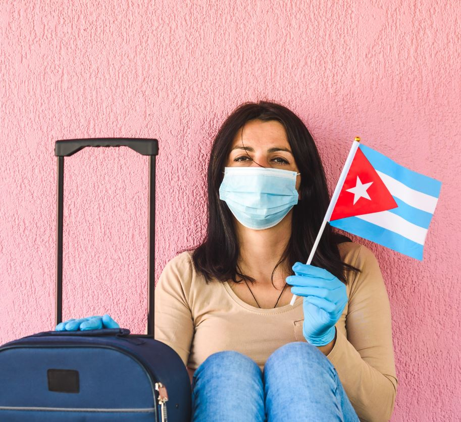 tourist with cuba flag in mask and luggage