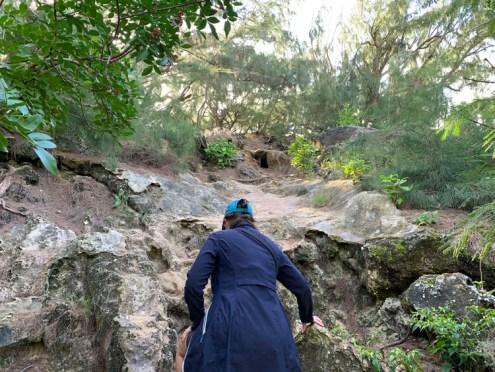 Mahaulepu Hike clamoring up the rocks