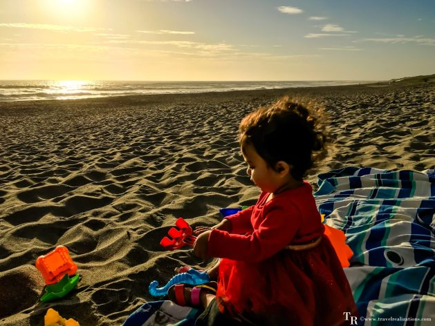 Travel Realizations, Moss Landing State Beach, California, Family Travel, A perfect family evening, baby playing on a seashore