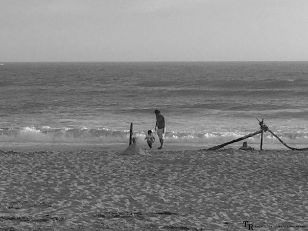 Travel Realizations, Moss Landing State Beach, California, Family Travel, A perfect family evening, baby walking with her dad on a seashore