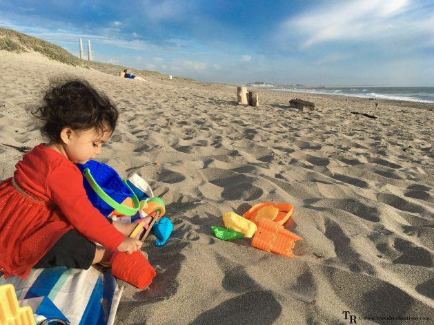 Travel Realizations, Moss Landing State Beach, California, Family Travel, A perfect family evening, baby on a seashore with her beach toys