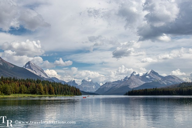 I saw a few tourists paddling across the world-famous Maligne Lake to remote backcountry shorelines, Travel Realizations