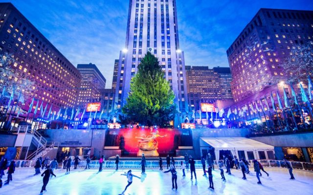 New York, United States - December 2, 2013: People ice skating at the rink under the traditional christmas tree at the Rockefeller Center, mid town manhattan.