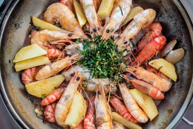 prawn fish seafood stew in garlic white wine sauce portuguese cataplana style
