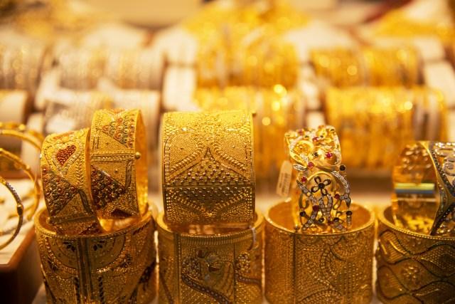 Gold bracelets in a store window in Deira Gold Souq, Dubai, United Arab Emirates (UAE)