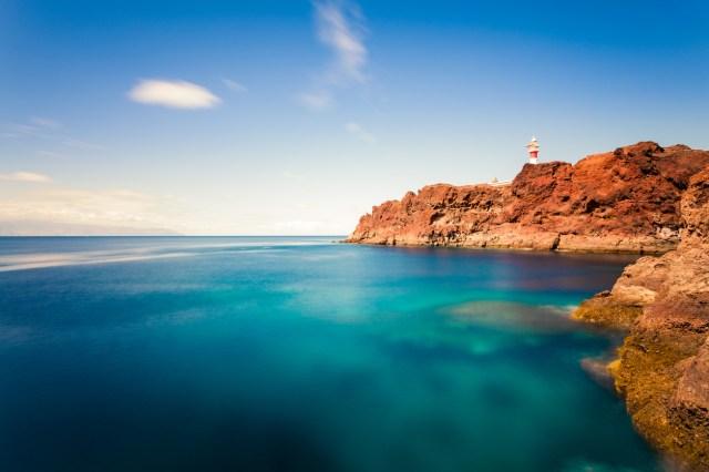 Lighthouse along rocky coast.