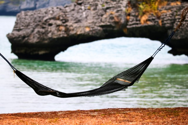 Cradle on the beach with nature stone bridge background at ang thong island Thailand.
