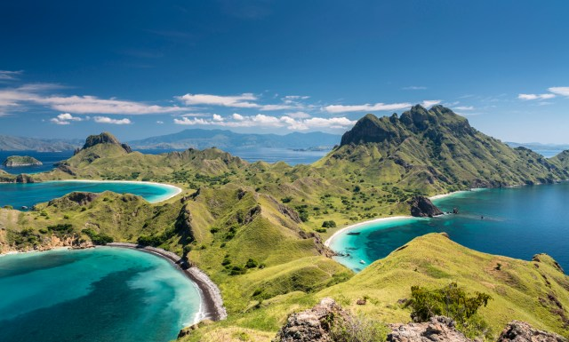 Aerial view of the island 'Pulau Padar' at the famous Komodo National Park in Indonesia. Komodo is world wide famous for the beautiful underwater life, the diving sites and the Komodo dragon. Secluded white sand beaches also spot the islands of the archipelago.