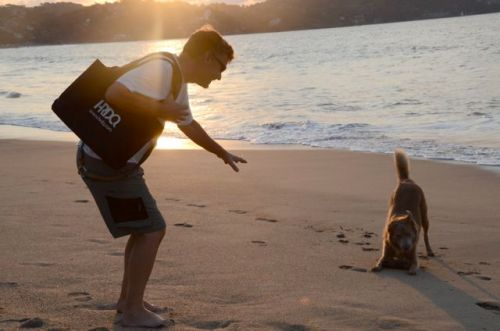 Stella playing with her Papa on the beach