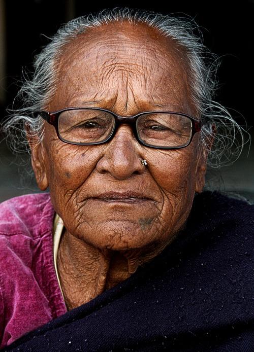 woman boudhanath best places to visit in kathmandu