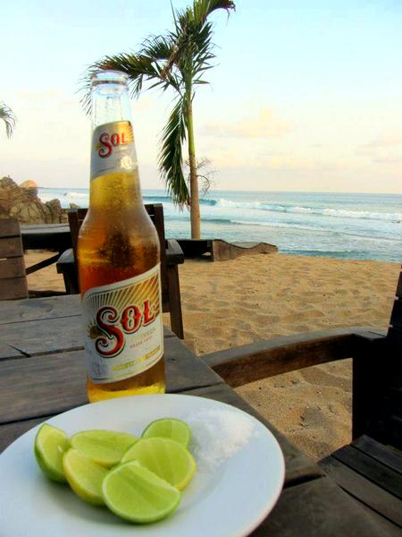 Sol beer and limes on Zipolite Beach, Mexico