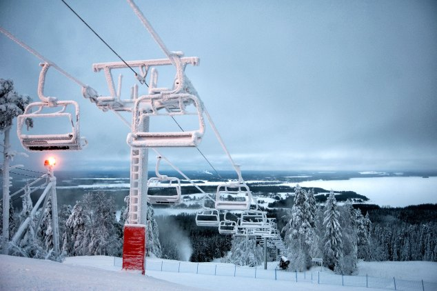 Icy ski lift and snowy slopes...