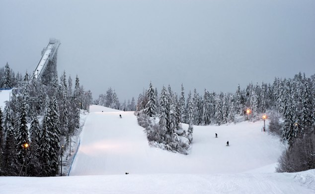 Dramatic snowy landscapes surround Vuokatti slopes and ski jump