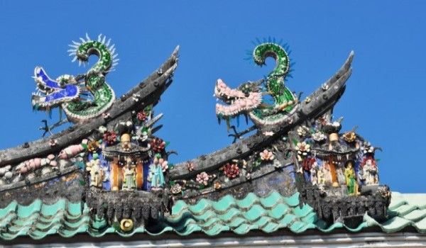 green dragons made of shard porcelain on top of Chinese temple ridge