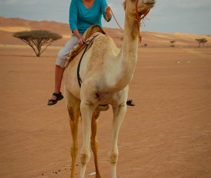 Life is good! Riding a Camel in Wahiba Sands Oman