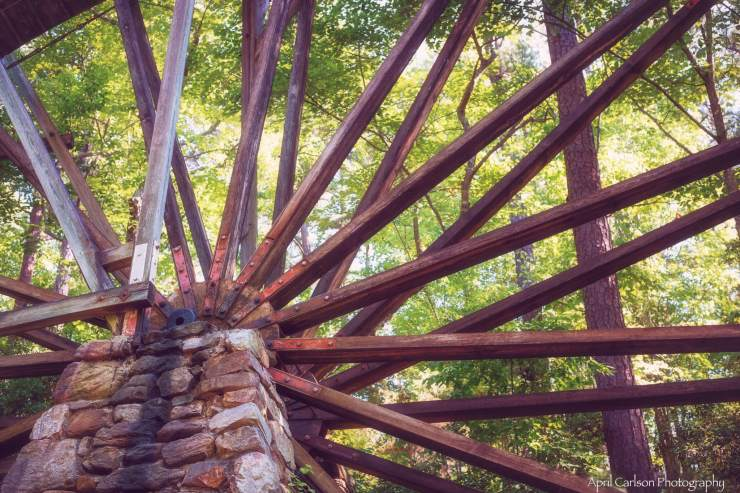 Close up photo of the mill wheel which is a beautiful berry color